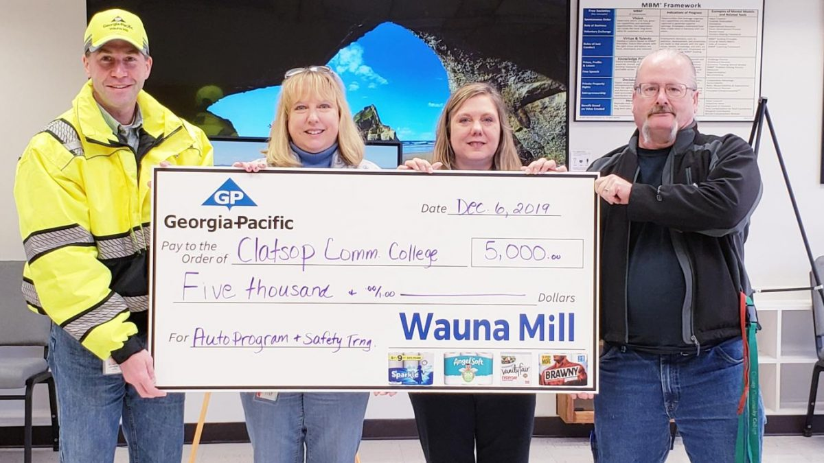 CCC and Wauna representatives holding check