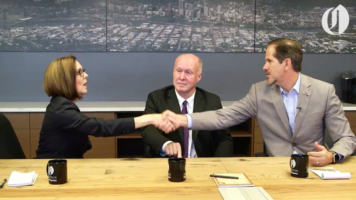 Patrick Starnes shakes hands with Governor Kate Brown