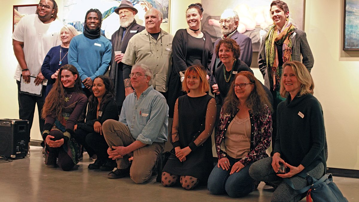 Artists who participated in the 2019 Au Naturel art exhibit pose for a photo