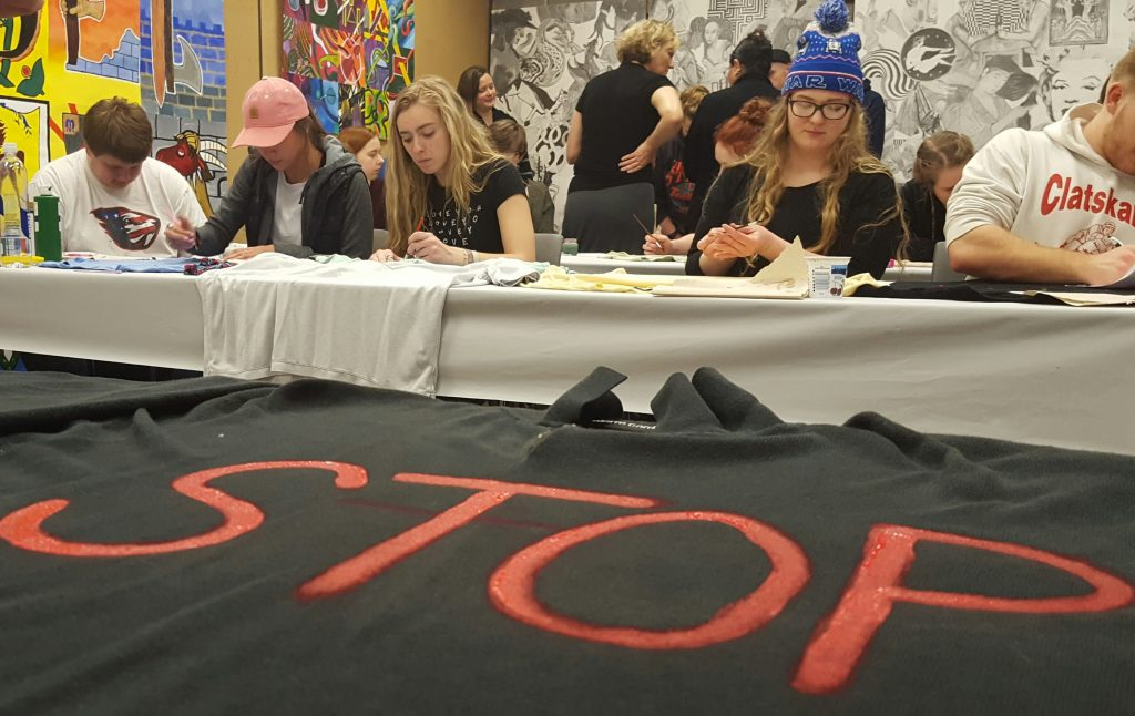 Students paint shirts to bring awareness to domestic violence