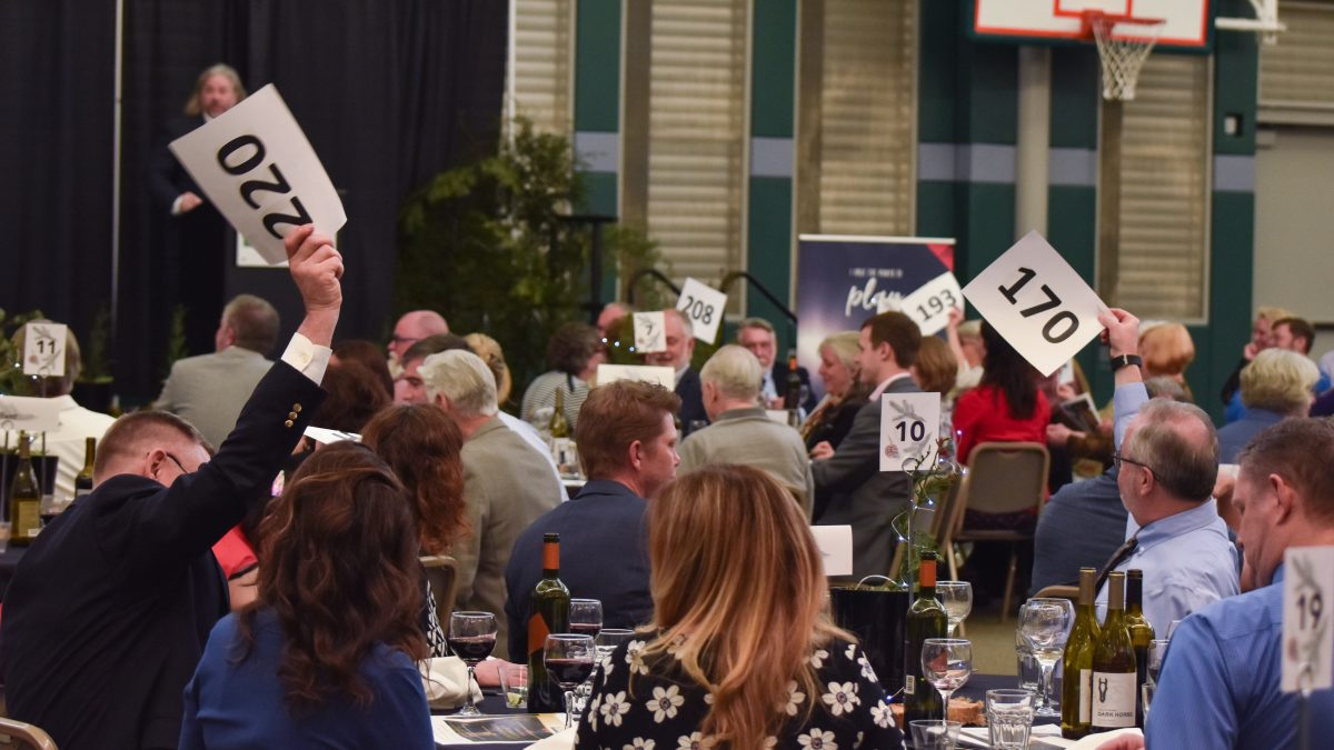 Auction attendees bid on items at the 2019 Foundation Auction and Dinner