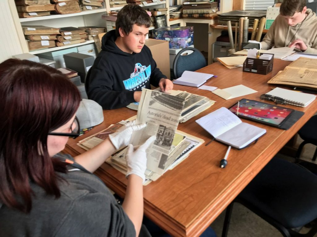 Upward Bound students research at the Clatsop County Historical Society for their e_History project