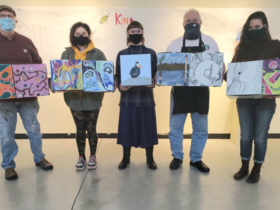 From left to right: CCC Painting students Jeff Donnelly, Allyson Preston, Arianna Nelson, Dick Magathan, and instructor Kristin Shauck showing off boxes by various participating CCC art students.
