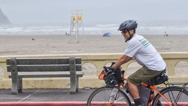 Fernando Rojas Galvan riding his bike at the Seaside Promenade