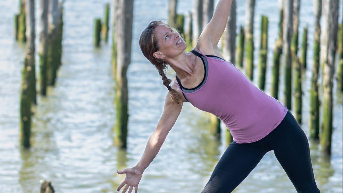 Julia Mabry practicing yoga. Photo credit by Kaye Floyd
