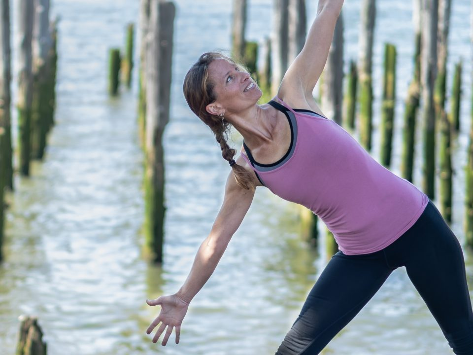 Julia Mabry practicing yoga. Photo credit by Kaye Floyd