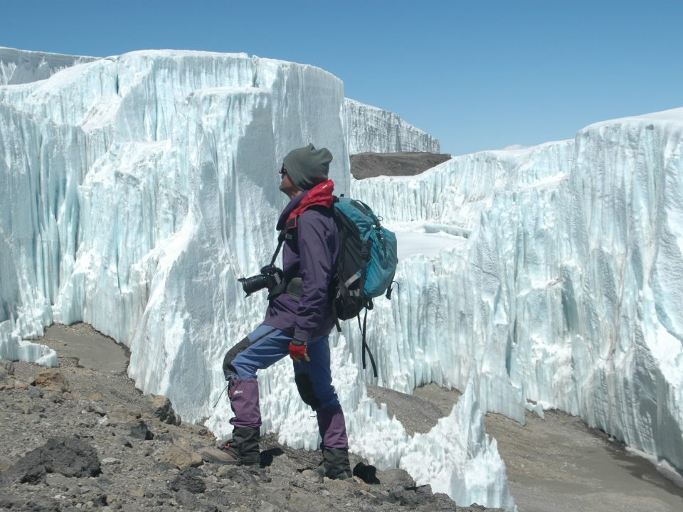 Peter G. Williams exploring the Northern Ice Field on the summit crater of Kilimanjaro, photo credit: Douglas Hardy