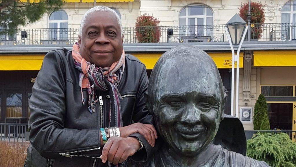 Ron Craig standing beside the Quincy Jones statue