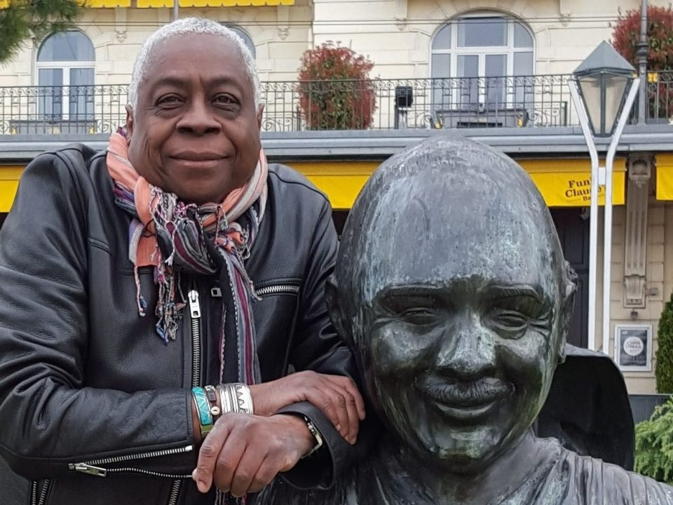 Ron Craig standing beside the Quincy Jones statue